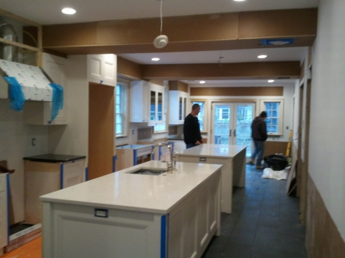 Cabinets in. Partial flooring and counter tops installed.