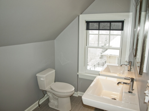 A new Gerber Avalanche toilet, along with an energy efficient Pella window were installed to complete the transformation.