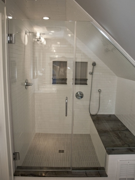 """A custom built shower with 1x6"""" Anatolia Zera Annex Silver tile on the shower floor, Silver Cloud granite accents, which offsets the bright, white ceramic tile make for a spa-like retreat.  Custom shower glass completes the shower transformation."""