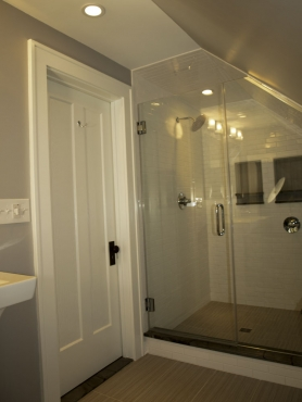 The beautiful, custom master shower is now housed in the original cedar closet.