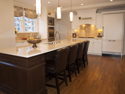 Island is constructed of dark stained cherry, while the perimeter cabinets are oil painted maple.