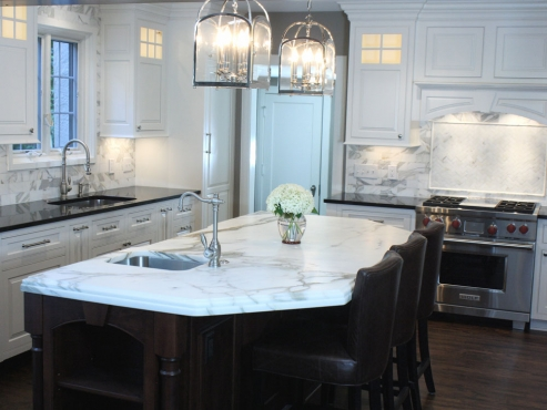 The Waterstone prep faucet, with a convenient air activated garbage disposal adds elegance and functionality to the kitchen island.